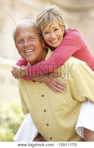 Senior Couple Having Fun In City