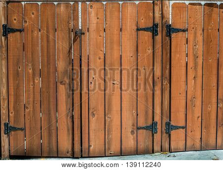 dog-ear shaped picket fence and gate and hinges
