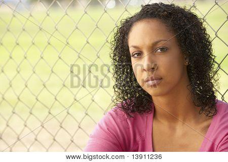 Teenage Girl Sitting In Playground