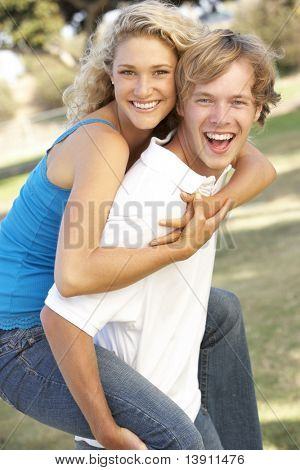 Teenage Couple Having Fun In Playground
