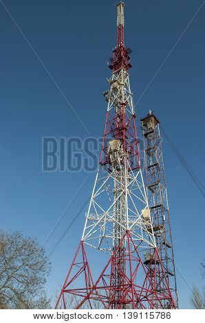 Telecommunications tower on a clear blue sky