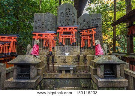 Fox sculpture in Fushimi Inari Shrine Kyoto Japan