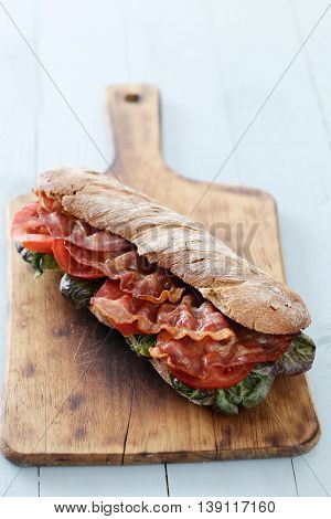 Delicious, long sandwich with bacon
