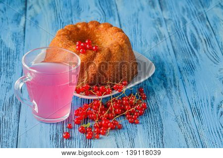 Pie Or Sponge Cake With Red Currants On A Wooden Background
