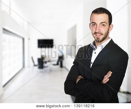 Young businessman smiling to the customers in his office