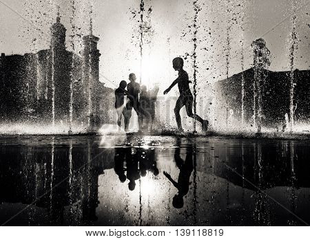 Children Playing In A Fountain
