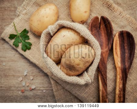 Fresh Organic Potatoes In Hemp Sake Bag With Parsley ,salt And Pepper On Rustic Wooden Table Prepara