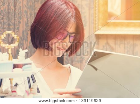 Nerdy Japanese girl is reading a blank book cover