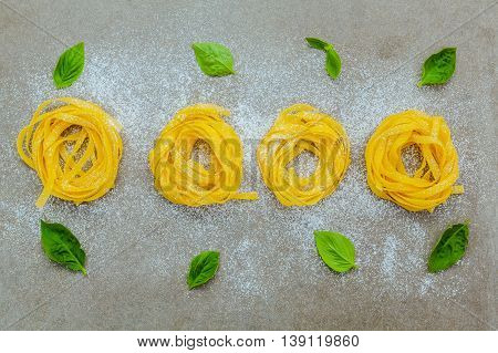 Italian Food Concept Pasta With Sweet Basil With Flour Setup On Concrete Background. Homemade Taglia