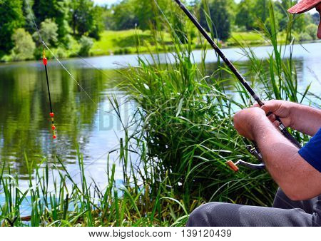 Close up of guy fishing on a lake