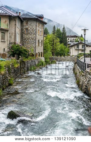 Water Flows In A Creek Between Stones In Ponte Di Legno, Italy