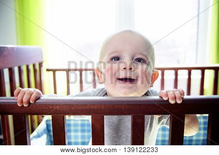 An Adorable baby boy in his crib