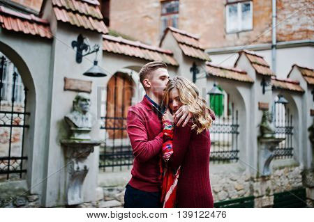 Young Beautiful Stylish Fashion Couple In A Red Dress In Love Story At The Old City