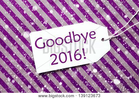 One Label On A Purple Striped Wrapping Paper. Textured Background With Snowflakes. Tag With Ribbon. English Text Goodbye 2016 For Happy New Year