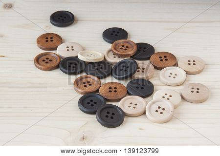 Wooden craft buttons on a wooden background.