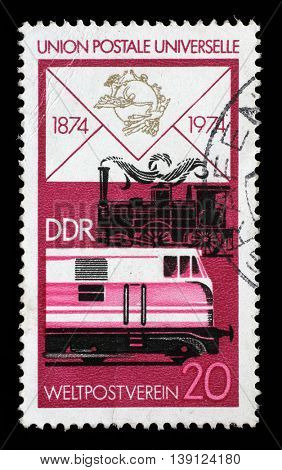 ZAGREB, CROATIA - JULY 02: a stamp printed in GDR shows Old Steam Locomotive and Modern Diesel, Centenary of the UPU, circa 1974, on July 02, 2014, Zagreb, Croatia