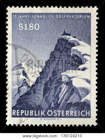 ZAGREB, CROATIA - JULY 03: a stamp printed by AUSTRIA shows view of Hoher Sonnblick summits with its Observatory located in Austrian Central Alps, circa 1962, on July 03, 2014, Zagreb, Croatia
