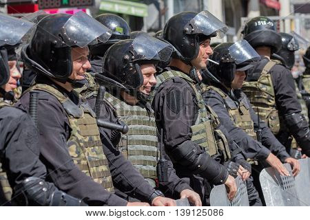 Kiev Ukraine - June 12 2016: Cordon of police wearing armor while protecting gay parade