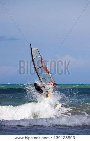 Flying over the waves with windsurfing ( sports )