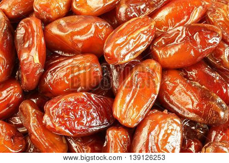 Dried sweet dates situated arbitrarily. Food background