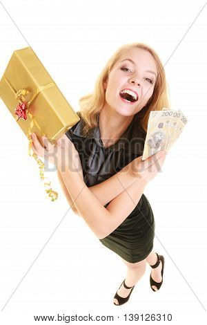 Happy smiling blonde girl young woman holding golden christmas gift box and polish currency money banknote. Holidays time for gifts.
