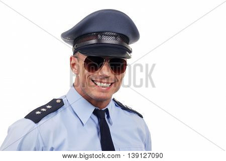 Portrait of young policeman in uniform with sunglasses