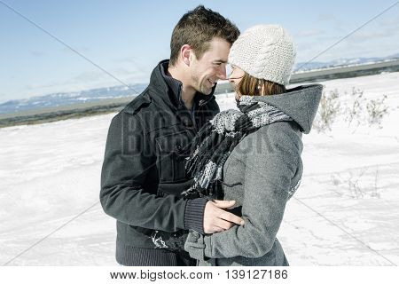 A Couple In winter Snow Scene at beautiful sunny day
