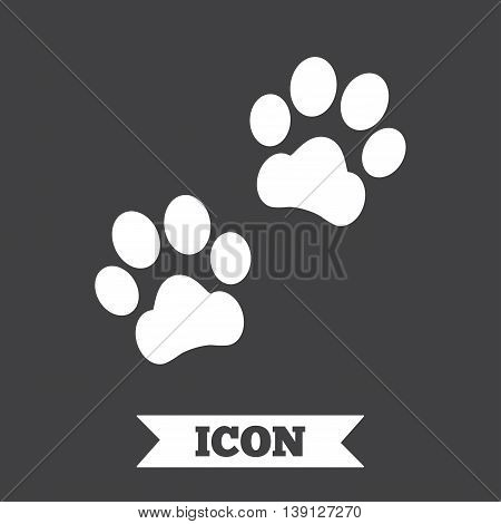 Paw sign icon. Dog pets steps symbol. Graphic design element. Flat paw steps symbol on dark background. Vector