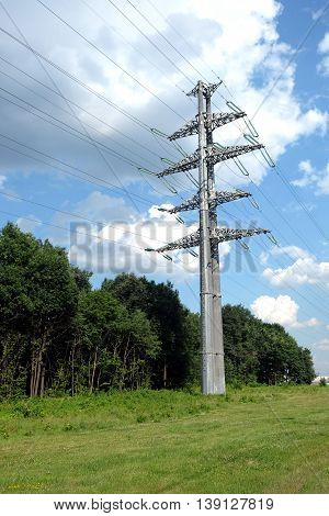 High-voltage power line gray metal props with many wires vertical view closeup