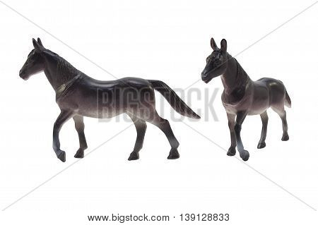 Isolated black horse toy profile and angle view photo.