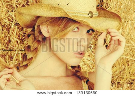 Pretty country girl wearing cowboy hat