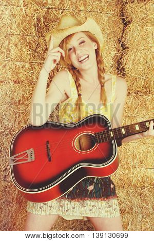 Beautiful country girl playing guitar