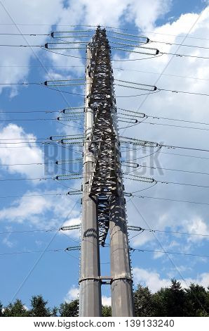 High-voltage power line gray metal prop with many wires side view closeup
