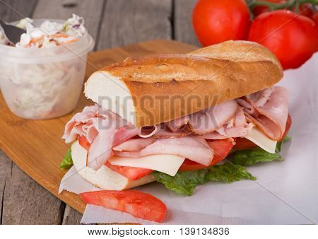 Ham sub sandwich with cheese tomato and lettuce