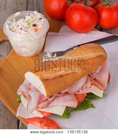 Ham sub sandwich made with cheese tomato and lettuce