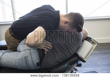 A Chiropractor male exercising therapy at office