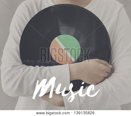 Female Holding Vinyl Music Graphic Concept