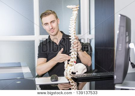 A Osteopath worker at job at the office