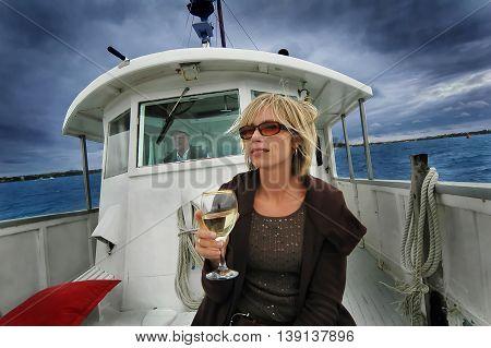 Lady on boat Enjoying wine, Auckland, New Zealand