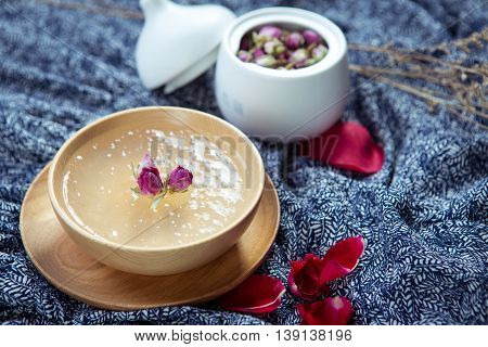 Sweet soup of salanganes or bird's nest in wooden bowl in restaurant