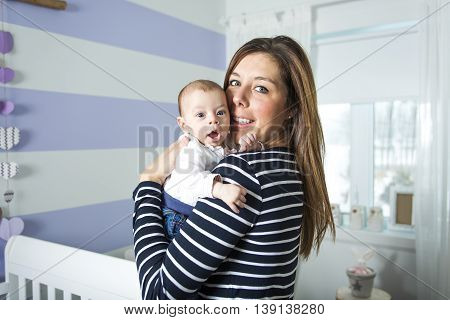 A young mother with a charming baby