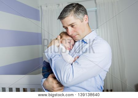 A Father and baby at home together, bedtime