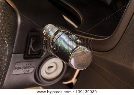 Car interior lighting control under steering switch