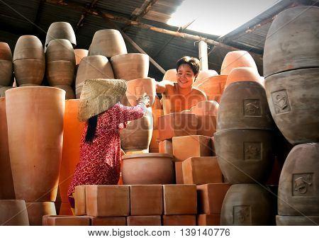 Vinh Long, Vietnam, June 18, 2016 man, woman, artisan, clay modeling pottery, traditional pottery village, Vinh Long, Vietnam