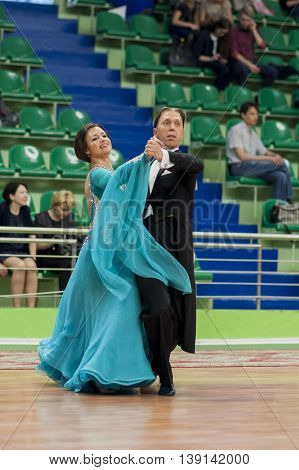 Minsk Belarus -May 29 2016: Senior Dance couple of Brizinskiy Alexander and Dobrovolskaya Tatiana performs Adult European Standard Program on National Championship of the Republic of Belarus in May 29 2016 in Minsk Belarus