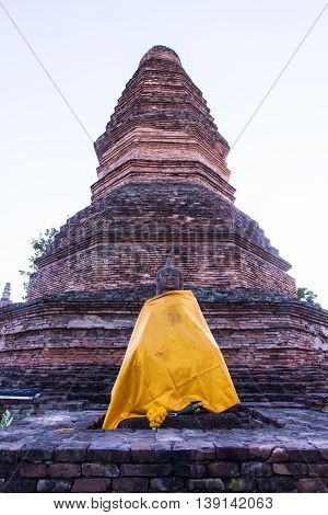 old Buddha statue with pagoda in wiang tha kan,Ancient City in chiangmai, Thailand