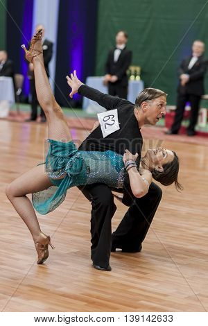 Minsk Belarus -May 29 2016: Senior Dance couple of Brizinskiy Aleksandr and Dobrovolskaya Tatiana performs Adult Latin-American Program on National Championship of the Republic of Belarus in May 29 2016 in Minsk Belarus