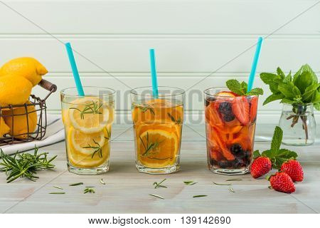 Closeup of detox water cocktails on wooden table.