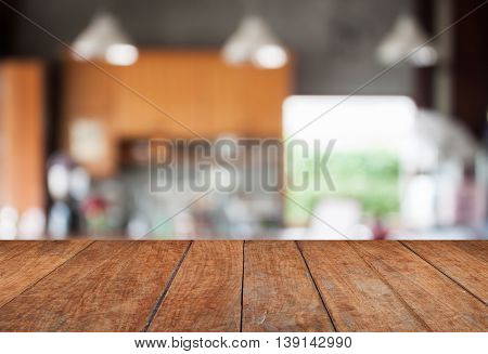 Tabletop with abstract blur coffee shop background, stock photo