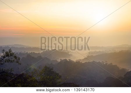 Mountain landscape background in the mist with sunrise.
